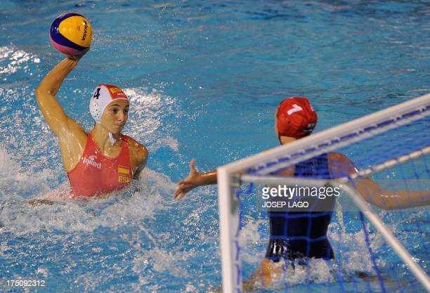 Spain's Roser Tarrago tries to score past Hungary's Flora Bolonyai during their women's water polo semifinal match at the FINA World Championships at...