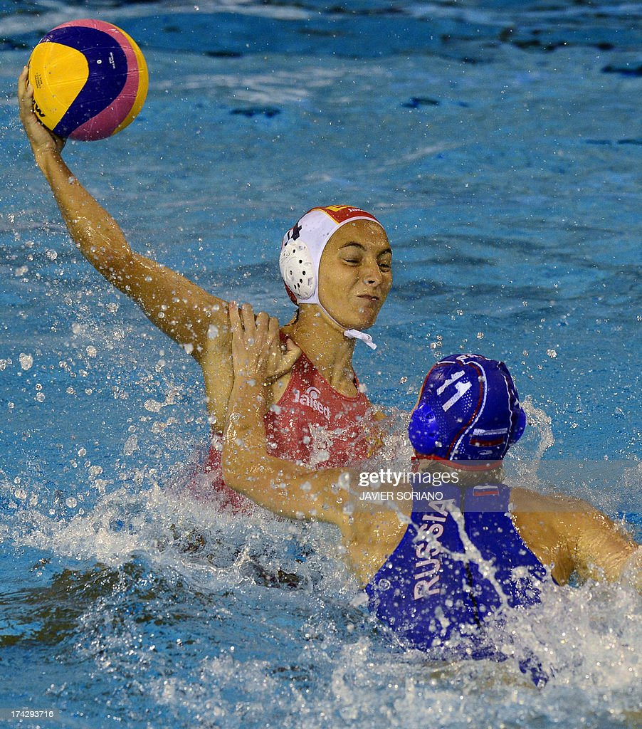 Spain's Roser Tarrago (L) vies with Russia's Olga Beliaeva (R) during the preliminary round match between Spain and Russia in the women's water polo competition at the FINA World Championships in Bernat Picornell pools in Barcelona on July 23, 2013. AFP PHOTO / JAVIER SORIANO