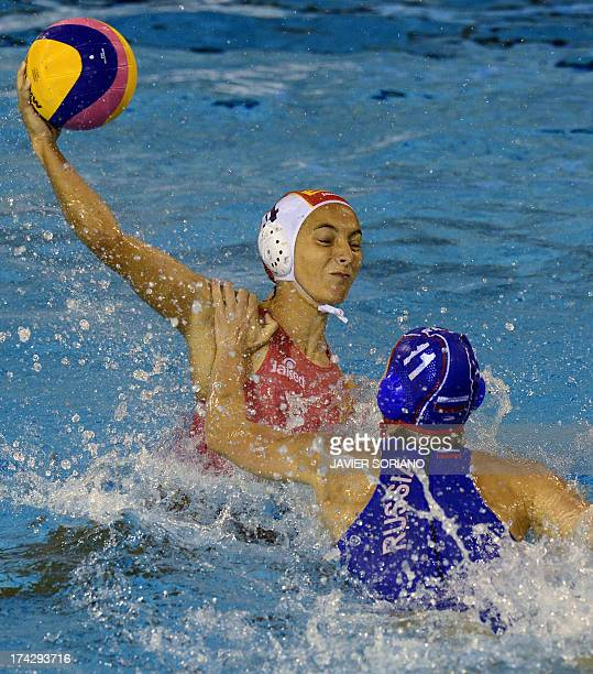 Spain's Roser Tarrago vies with Russia's Olga Beliaeva during the preliminary round match between Spain and Russia in the women's water polo...