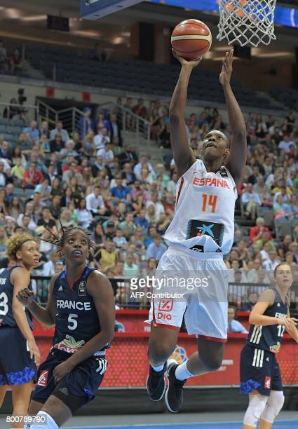 Spain's Sancho Lyttle jumps with a ball watched by France's Endene Miyem during the FIBA EuroBasket 2017 women's final match between Spain and France...