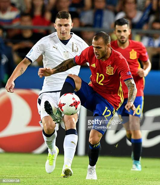 Spain's Sandro Ramirez and Italy's Mattia Caldara vie for the ball during the UEFA U21 European Championship football semi final match Spain v Italy...