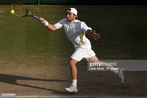 Spain's Santiago Ventura and Marcel GranollersPujol in action against USA's Bob and Mike Bryan in their doubles match during the Wimbledon...