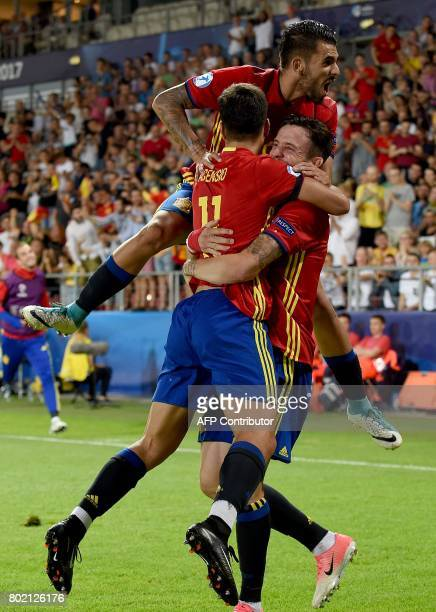 Spain's Saul Niguez Marco Asensio and Daniel Ceballos react after Niguez scored a goal during the UEFA U21 European Championship football semi final...