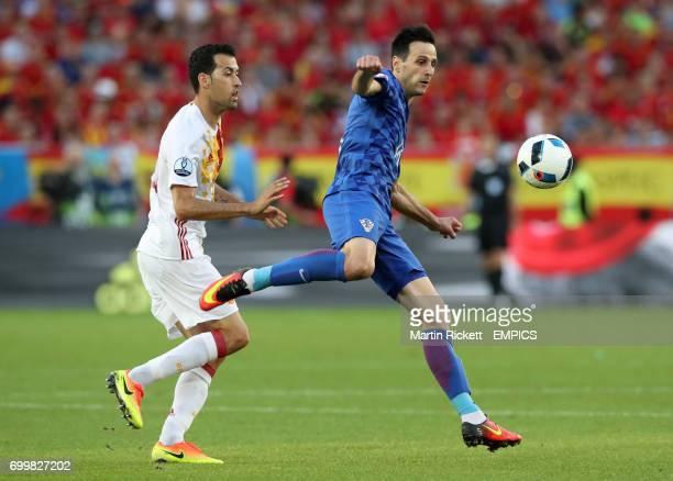 Spain's Sergio Busquets and Croatia's Nikola Kalinic battle for the ball