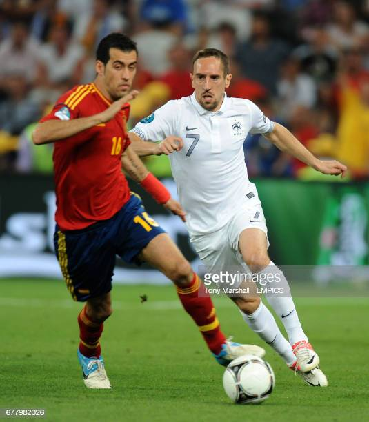 Spain's Sergio Busquets and France's Franck Ribery