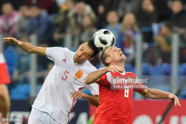 Spain's Sergio Busquets and Russia's Denis Glushakov vie for the ball during an international friendly football match between Russia and Spain at the...