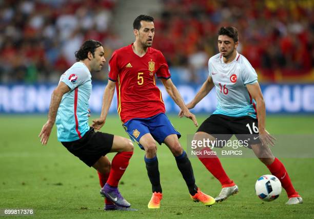 Spain's Sergio Busquets in action with Turkey's Selcuk Inan and Ozan Tufan