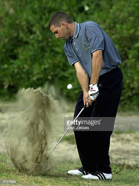 Spain's Sergio Garcia hits out from a rough on the 8th hole during the third day of the Seve Trophy 2003 at the EL Saler golf club in Valencia 08...