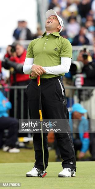Spain's Sergio Garcia looks dejected after missing a putt on the 18th to win the Open Championship during the Final day of The 136th Open...