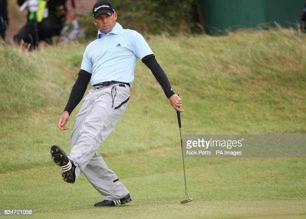 Spain's Sergio Garcia reacts after a putt on the 13th green during Round One of the Open Championship at the Royal Birkdale Golf Club Southport