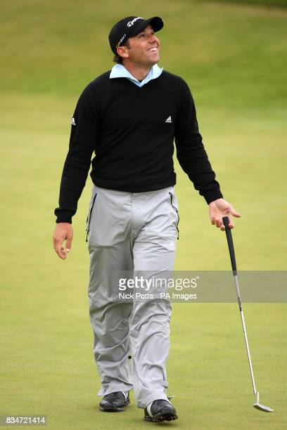 Spain's Sergio Garcia reacts after missing a putt on the 8th hole during Round One of the Open Championship at the Royal Birkdale Golf Club Southport