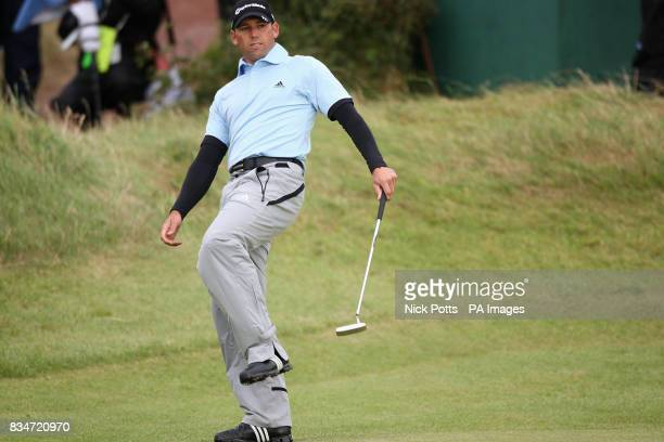 Spain's Sergio Garcia reacts on the 13th green during Round One of the Open Championship at the Royal Birkdale Golf Club Southport