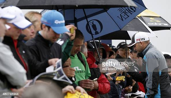 Spain's Sergio Garcia signs autographs for fans during a practice round on The Old Course at St Andrews in Scotland on July 15 ahead of The 2015 Open...