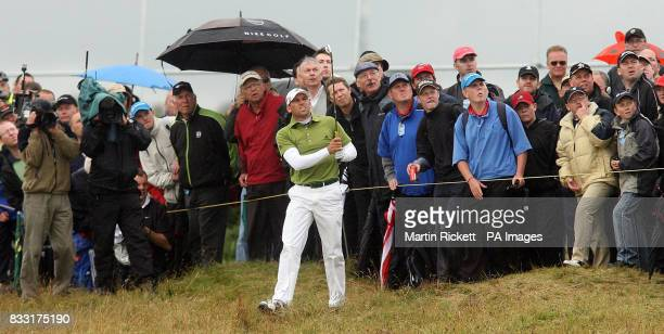 Spain's Sergio Garcia watches his shot from the rough during the Final day of The 136th Open Championships at Carnoustie Scotland