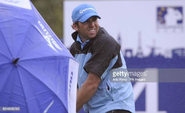 Spain's Sergio Garcia watches his tee shot as he takes cover from the weather during the European Open at The London Golf Club Ash Kent