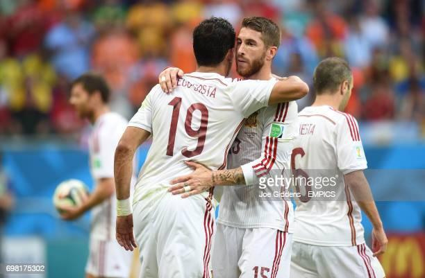 Spain's Sergio Ramos congratulates teammate Diego Costa on winning a penalty