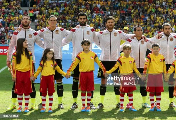 Spain's Sergio Ramos Fernando Torres Raul Albiol Xabi Alonso Santi Cazorla and Jordi Alba during the national anthems