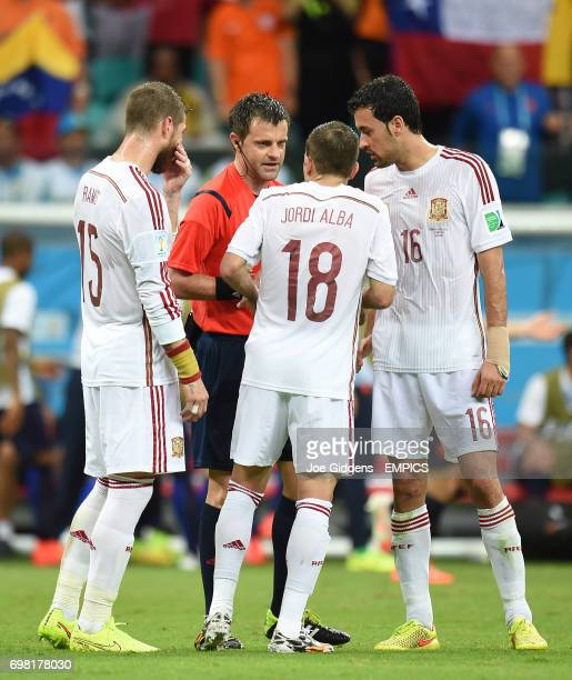 Spain's Sergio Ramos Jordi Alba and Sergio Busquets appeals to referee Nicola Rizzoli after Netherland's' Stefan de Vrij scores his side's third goal