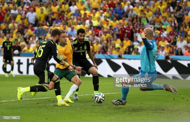 Spain's Sergio Ramos Raul Albiol and Pepe Reina battle for the ball with Australia's Adam Taggart