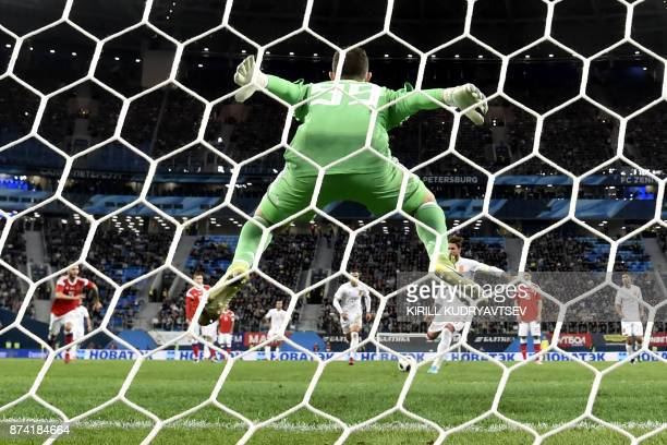 TOPSHOT Spain's Sergio Ramos shoots from the penalty spot to score the team's second goal during an international friendly football match between...