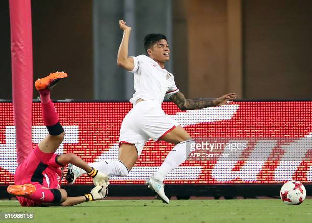 Spain's Sevilla FC midfielder Joaquin Correa and Japan's Cerezo Osaka goalkeeper Kim Jin Hyeon fight for the ball during their friendly match in...