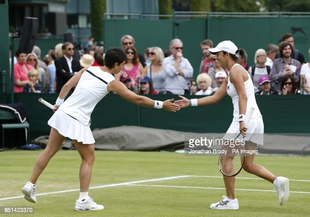 Spain's Silvia SolerEspinosa and Carla Suarez Navarro celebrate a point against Great Britain's Melanie South and Tara Moore during day four of the...
