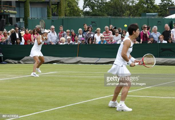 Spain's Silvia SolerEspinosa and Carla Suarez Navarro in action against Great Britain's Melanie South and Tara Moore during day four of the Wimbledon...
