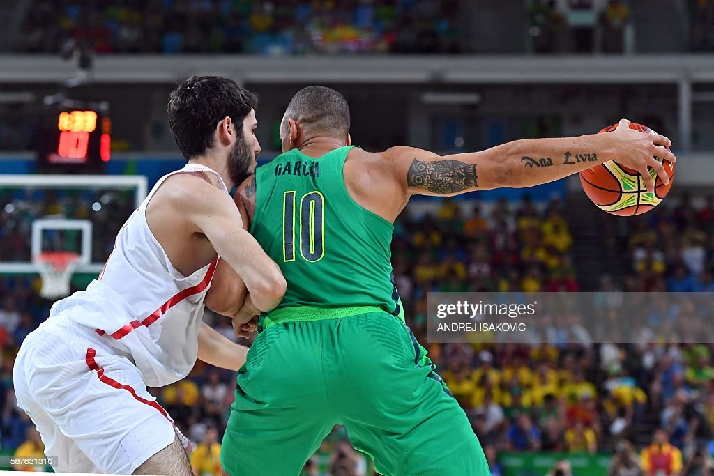 TOPSHOT Spain's small forward Alex Abrines defends against Brazil's small forward Alex Garcia during a Men's round Group B basketball match between...