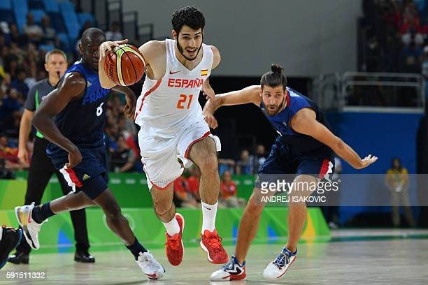 Spain's small forward Alex Abrines runs during a Men's quarterfinal basketball match between Spain and France at the Carioca Arena 1 in Rio de...