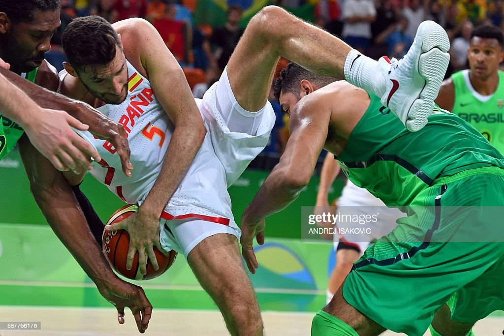 TOPSHOT Spain's small forward Rudy Fernandez loses his balance during a Men's round Group B basketball match between Spain and Brazil at the Carioca...