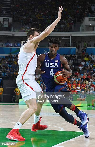 Spain's small forward Victor Claver covers USA's forward Jimmy Butler during a Men's semifinal basketball match between Spain and USA at the Carioca...
