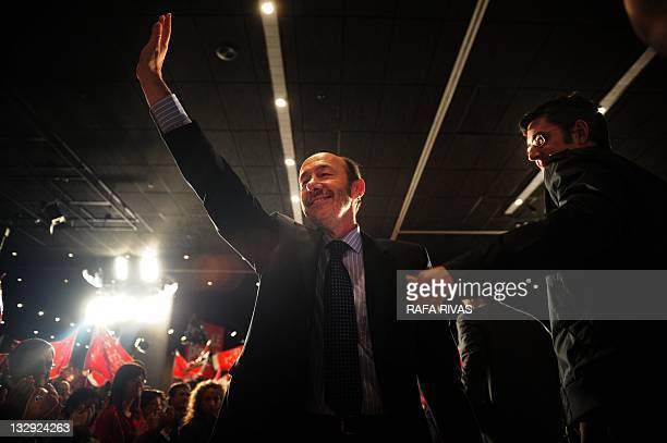 Spain's Socialist Party candidate in the upcoming general elections Alfredo Perez Rubalcaba waves to supporters next to PSOE's candidate for Vizcaya...