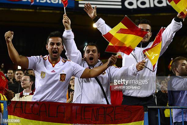 Spain's supporters cheer their team during the FIFA World Cup 2014 qualifying football match Spain vs France on October 16 2012 at Vicente Calderon...