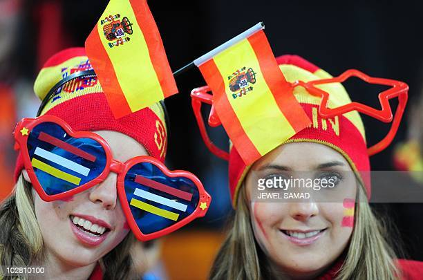 Spain's supporters wear hats with Spanish flags prior the 2010 World Cup football final between the Netherlands and Spain on July 11 2010 at Soccer...