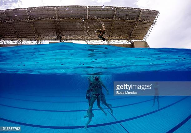 Spain's team dives into the pool during a training session of the FINA Olympic Games Synchronised Swimming Qualification Tournament Aquece Rio Test...