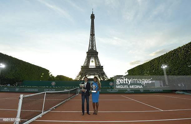 Spain's tennis player Rafael Nadal and US tennis player Serena Williams pose for photographers on a tennis court built in front of the Eiffel tower...