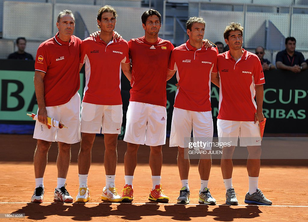 Spain's tennis team (L to R) Spain's captain Alex Corretja, Spain's Rafael Nadal, Spain's Fernando Verdasco, Spain's Tommy Robredo and Spain's Marc Lopez stand for their National Anthem before the World Group Play-offs 2013 against Ukraine at the Caja Magica sports complex in Madrid on September 13, 2013. Winning nations qualify for the World Group in 2014.