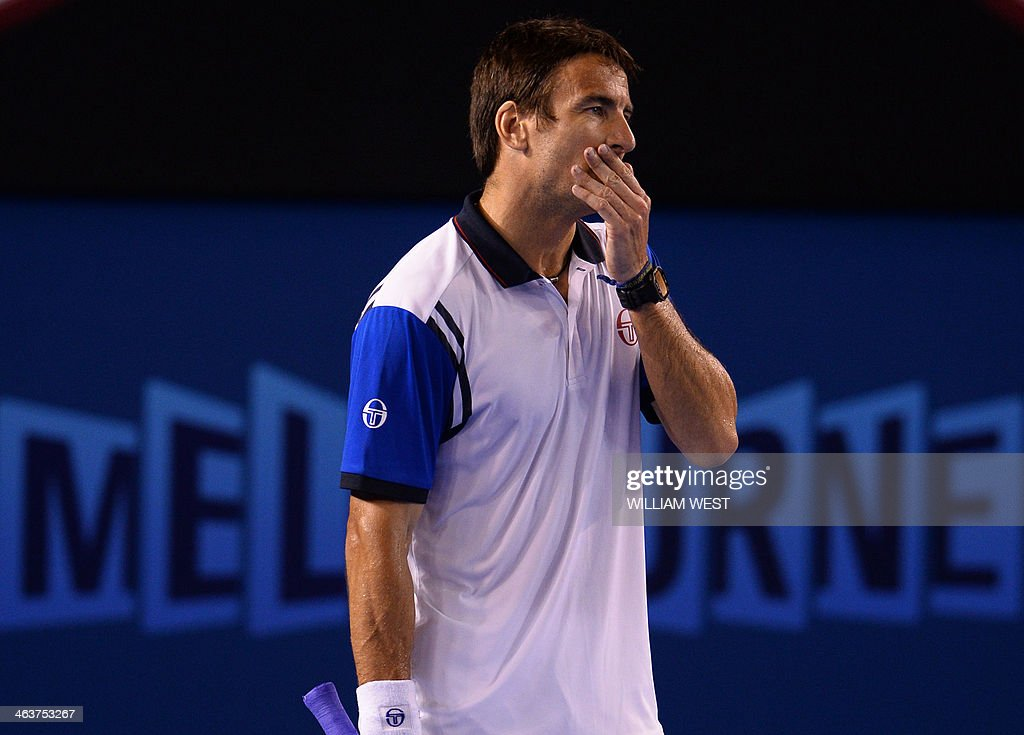 Spain's Tommy Robredo gestures during his men's singles match against Switzerland's Stanislas Wawrinka on day seven of the 2014 Australian Open tennis tournament in Melbourne on January 19, 2014. IMAGE