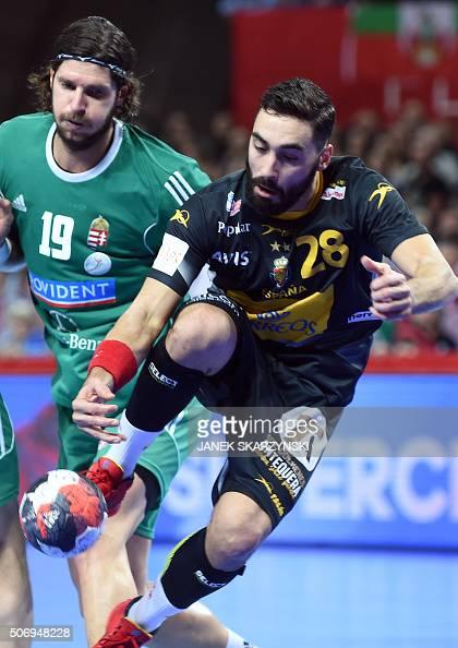 Spain's Valero Rivera vies with Hungary's Laszlo Nagy during the Men's 2016 EHF European Handball Championships between Spain and Hungary in...