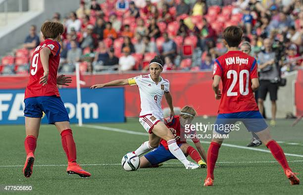 Spain's Veronica Boquete is surround by South Korea's Kim Hyeri Park Eunsun and Kang Yumi during a 2015 FIFA Women's World Cup Group E football match...