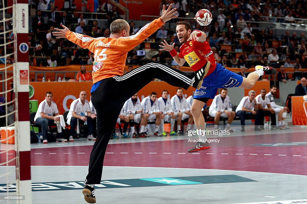 Spain's <a gi-track='captionPersonalityLinkClicked' href=/galleries/search?phrase=Victor+Tomas&family=editorial&specificpeople=3260334 ng-click='$event.stopPropagation()'>Victor Tomas</a> (R) in action against France's goalkeeper <a gi-track='captionPersonalityLinkClicked' href=/galleries/search?phrase=Thierry+Omeyer&family=editorial&specificpeople=853674 ng-click='$event.stopPropagation()'>Thierry Omeyer</a> (16) during the 24th Men's Handball World Championships semifinal handball match between Spain and France at the Lusail Sports Arena in Doha, Qatar on January 30, 2015.