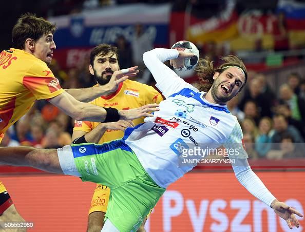 TOPSHOT Spain's Viran Morros de Argila and Jorge Maqueda vie for the ball with Slovenia's Dean Bombac during the Men's 2016 EHF European Handball...