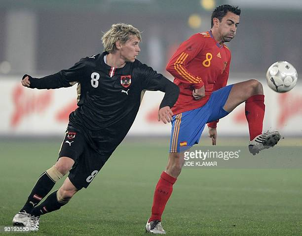Spain's Xavi fights for a ball with Austria's Cristoph Leitgeb during the friendly football match between Austrian and Spain at Ernst Happel stadium...