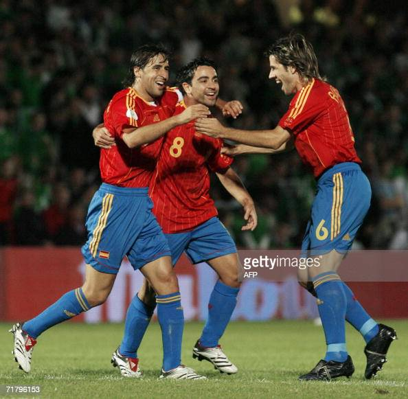 Spain's Xavi Hernandez celebrates after scoring with team mate Raul Gonzalez and David Albelda against Northern Ireland 06 September 2006 during...