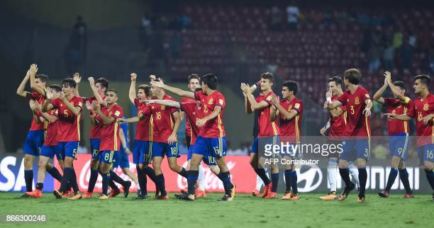 Spain'splayers celebrate after winning their semifinal football match against Mali during the FIFA U17 World Cup at the DY Patil stadium in Navi...