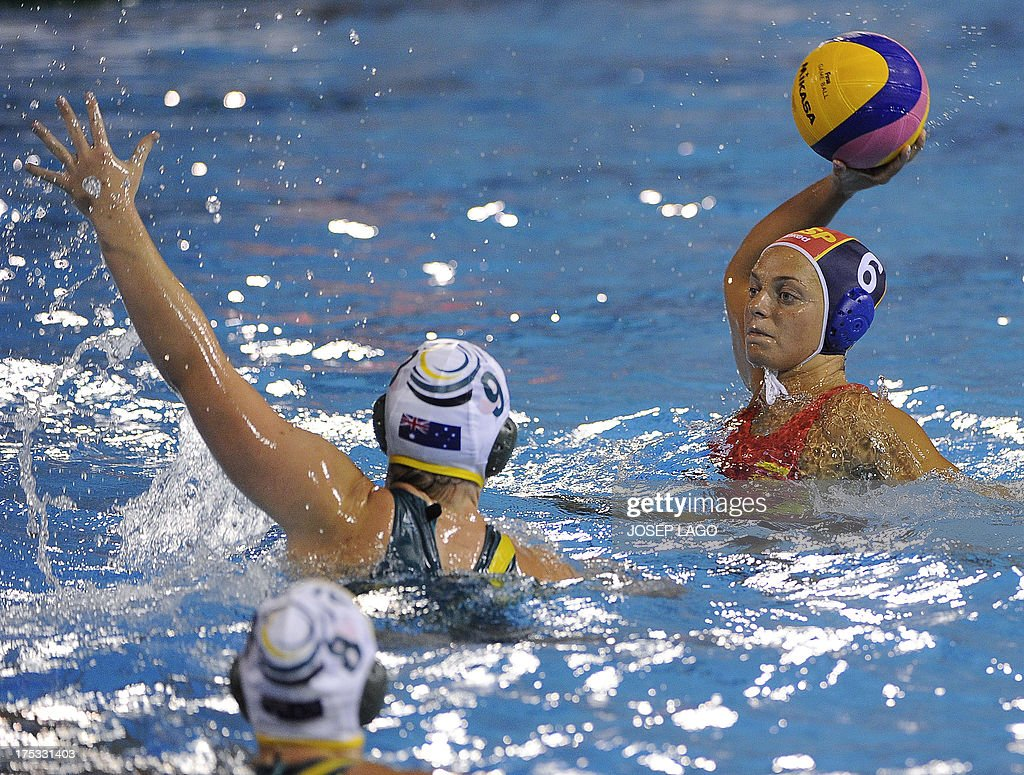 Spains's Jennifer Pareja vies with Australia's Zoe Aranzini during the women's water polo gold medal final match between Australia and Spain at the...