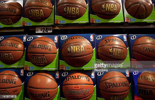 Spalding basketballs branded with the National Basketball Association logo are displayed for sale at a Modell's retail location in Times Square in...