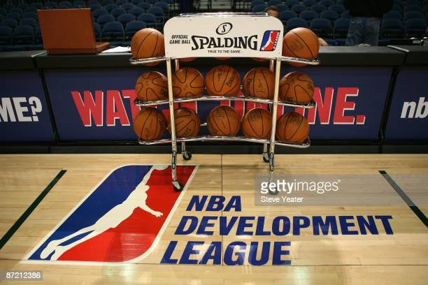 Spalding basketballs on a ball rack and the DLeague logo are shown on the court before the Reno Bighorns game against the Erie BayHawks at the Reno...