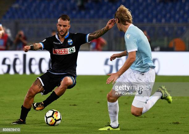 Spal's Italian defender Filippo Costa vies with Lazio's Serbian defender Dusan Basta during the Italian Serie A football match between Lazio and Spal...