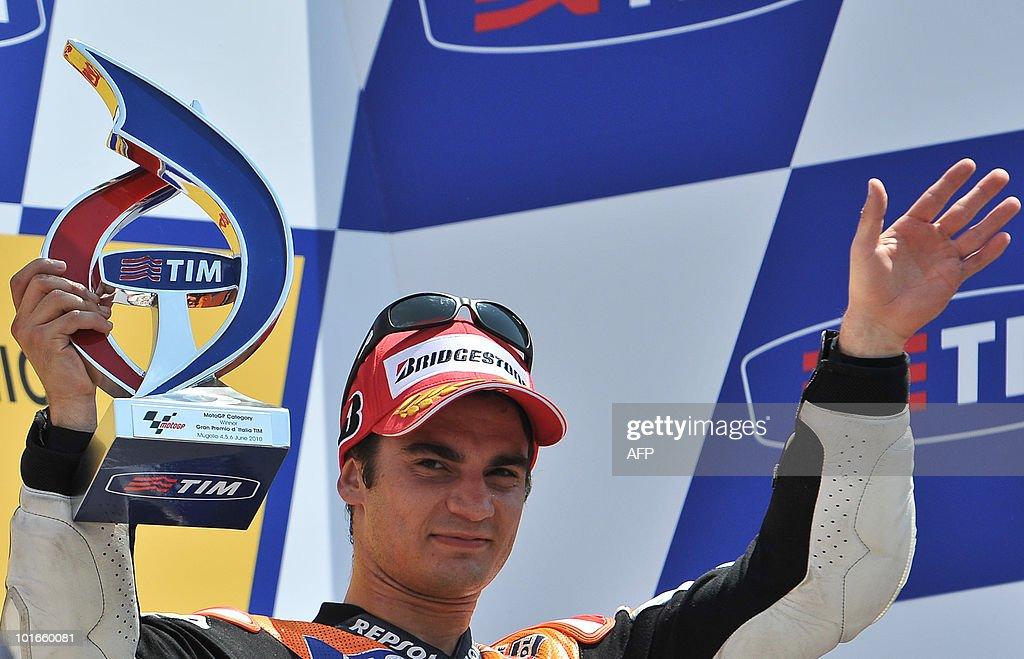 Spaniard Dani Pedrosa of the Respol Honda team celebrates his victory on the podium of the Moto GP at the Italian Grand Prix at the Mugello ractrack on June 6, 2010.